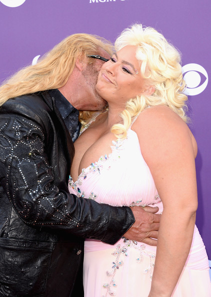 48th Annual Academy Of Country Music Awards - Arrivals [dog the bounty hunter,blond,lady,interaction,event,dress,kiss,photography,gesture,arrivals,tv personalities,beth chapman,las vegas,nevada,mgm grand garden arena,l,academy of country music awards]
