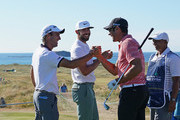 Edoardo Molinari of Italy celebrates with Erik van Rooyen of South Africa and Alvaro Velasco of Spain after he makes a hole in one on the par three 14th hole during the second round of the Dubai Duty Free Irish Open at Ballyliffin Golf Club on July 6, 2018 in Donegal, Ireland.
