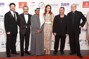 "Producer Keith Rodger, actor Yilmaz Erdogan, DIFF Chairman Abdulhamid Juma, actors Olga Kurylenko, Cem Yilmaz and producer Andrew Mason attend ""The Water Diviner"" premiere during day two of the 11th Annual Dubai International Film Festival held at the Madinat Jumeriah Complex on December 11, 2014 in Dubai, United Arab Emirates."