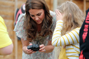 Catherine, Duchess of Cambridge and photographer Jillian Edelstein join a photography workshop for Action for Children, run by the Royal Photographic Society at Warren Park on June 25, 2019 in Kingston, England.