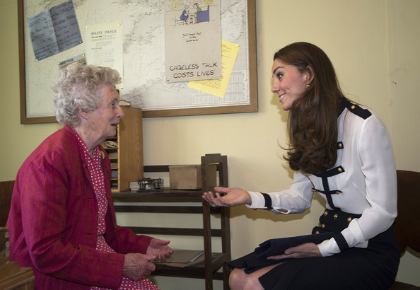 Catherine, Duchess Of Cambridge talks to Bletchley veteran Lady Marion Body, who knew her Grandmother, during a tour the of the restored WWII Codebreaking Huts at Bletchley Park on June 18, 2014 in Bletchley, England. The pre-fabricated wooden huts that housed the secret Government code breaking school during WWII, where encrypted messages sent by the Navy, Army and Air Forces of Germany and its allies were decrypted, translated and analysed for vital intelligence, have undergone a year long restoration.