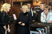 Camilla, The Duchess of Cornwall (C) meets actors Beverly Callard, who plays landlady Liz McDonald (L), Anne Kirkbride, who plays the role of Deirdre Barlow (R) and Ryan Thomas, who plays the role of Jason Grimshaw (R) during a visit to the Rovers Return Pub during a tour of the Coronation Street set on February 4, 2010 in Manchester, England.
