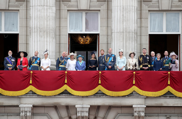 Members Of The Royal Family Attend Events To Mark The Centenary Of The RAF [timothy laurence,members,princess,prince,charles,harry,andrew,elizabeth ii,richard,the royal family attend events to mark the centenary of the raf,red,social group,yellow,event,crowd,team,flag,government,tourism]