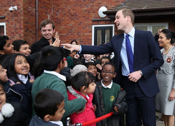 Prince William, Duke of Cambridge meets school children as he leaves St Basil's Charity project on November 29, 2013 in Birmingham, England. St Basil's is a Youth Homeless charity supported by Centrepoint, the homeless charity of which Prince William is Patron.