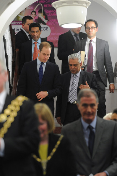 Prince William, Duke of Cambridge (L) speaks to Councillor Mahmood Hussain from Birmingham City Council during his visit to South and City College on November 29, 2013 in Birmingham, England.