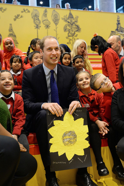Prince William, Duke of Cambridge holds a card made by the young children from Chandos Primary School during story time as he visits Birmingham Library on November 29, 2013 in Birmingham, England.