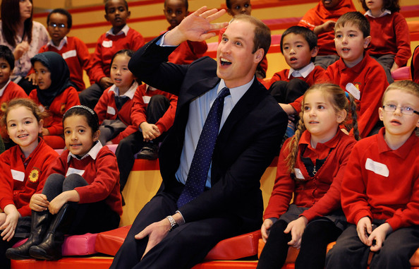 Prince William, Duke of Cambridge with young children from Chandos Primary School during story time as he visits Birmingham Library on November 29, 2013 in Birmingham, England.