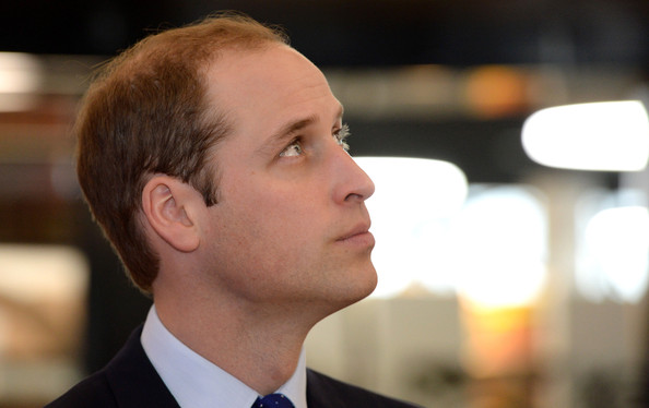 Prince William, Duke of Cambridge looks up to watch poet laureate Stephen Morrison-Burke reciting a poem as he visits Birmingham Library on November 29, 2013 in Birmingham, England.