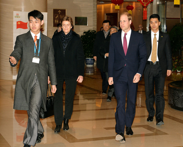 Prince William, Duke of Cambridge walks with British Ambassador Barbara Woodward after arriving at Beijing International Airport from Japan on March 1, 2015 in China.