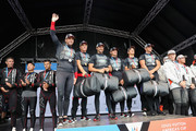 Sir Ben Ainslie (L) and the Land Rover BAR team celebrate winning the America's Cup 2016 on stage at the America's Cup World Series on July 24, 2016 in Portsmouth, England.