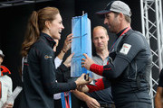 Catherine, Duchess of Cambridge and Prince William, Duke of Cambridge present Sir Ben Ainslie with the America's Cup 2016 trophy on stage at the America's Cup World Series on July 24, 2016 in Portsmouth, England.