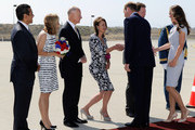 Lady Julia Sheinwald (C), wife of  British Ambassador Sir Nigel Sheinwald, greets Prince William, Duke of Cambridge and Catherine, Duchess of Cambridge as they arrive at Los Angeles International Airport on July 8, 2011 in Los Angeles, California. Also pictured are (L-R) Los Angeles Mayor Antonio Villaraigosa, California Governor Jerry Brown, and his wife Anne Gust, who is holding a red white and blue bouquet of flowers for the Duchess of Cambridge. The newly married Royal Couple are on a three day visit to Southern California.