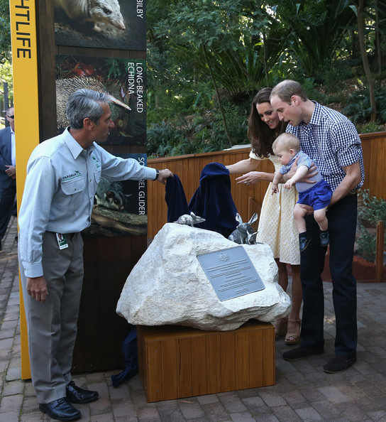 Catherine, Duchess of Cambridge, Prince George of Cambridge and Prince William, Duke of Cambridge unveil a plaque for the new Bilby Enclosure at Taronga Zoo on April 20, 2014 in Sydney, Australia. The Duke and Duchess of Cambridge are on a three-week tour of Australia and New Zealand, the first official trip overseas with their son, Prince George of Cambridge.