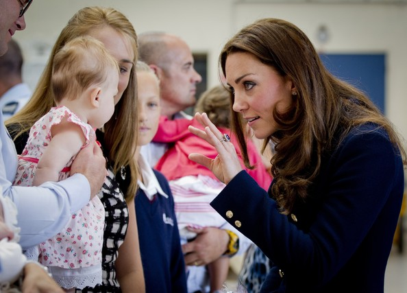 Catherine, Duchess of Cambridge greets 5-month-old Madeleine Tilbury and mother, Melissa Tilbury after arriving at Whenuapai on April 11, 2014 in Auckland, New Zealand.  The Duke and Duchess of Cambridge are on a three-week tour of Australia and New Zealand, the first official trip overseas with their son, Prince George of Cambridge.