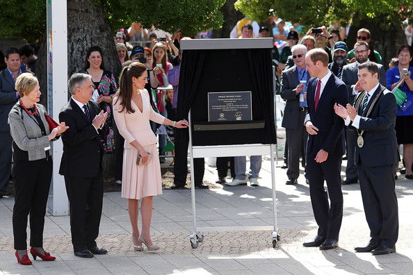 Catherine, Duchess of Cambridge and Prince William, Duke of Cambridge unveil a plaque to commemorate the naming of 'Prince Georhge Plaza' on April 23, 2014 in Adelaide, Australia. The Duke and Duchess of Cambridge are on a three-week tour of Australia and New Zealand, the first official trip overseas with their son, Prince George of Cambridge.