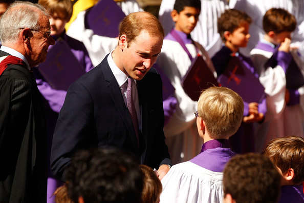 Prince William, Duke of Cambridge speaks with choir boys outside St Andrew's Cathedral following a Easter Sunday Service on April 20, 2014 in Sydney, Australia. The Duke and Duchess of Cambridge are on a three-week tour of Australia and New Zealand, the first official trip overseas with their son, Prince George of Cambridge.