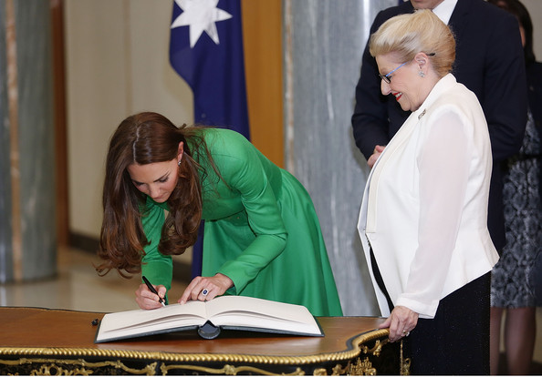 Catherine, the Duchess of Cambridge signs the Prime Minister's and Presiding Officer's Visitors books on the Queen Victoria Writing Table in the Marble Foyer at Parliament House on April 24, 2014 in Canberra, Australia. The Duke and Duchess of Cambridge are on a three-week tour of Australia and New Zealand, the first official trip overseas with their son, Prince George of Cambridge.