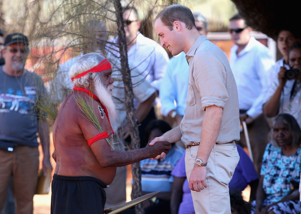 Prince William, Duke of Cambridge meets an indigenous man during a visit to Uluru-Kata Tjuta Cultural Centre on April 22, 2014 in Ayers Rock, Australia. The Duke and Duchess of Cambridge are on a three-week tour of Australia and New Zealand, the first official trip overseas with their son, Prince George of Cambridge.