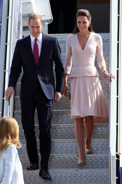 Prince William, Duke of Cambridge and Catherine, Duchess of Cambridge arrive at RAFF Base Edinburgh on April 23, 2014 in Adelaide, Australia. The Duke and Duchess of Cambridge are on a three-week tour of Australia and New Zealand, the first official trip overseas with their son, Prince George of Cambridge.