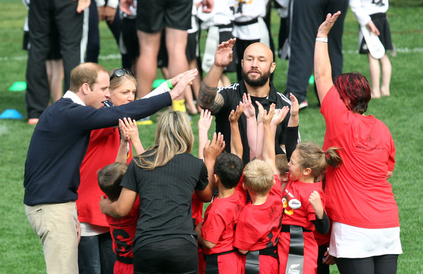 Prince William, Duke of Cambridge and All Blacks Sevens captain DJ Forbes celebrate with the junior rippa rugby players at Forsyth Barr Stadium, Dunedin on April 13, 2014 in Dunedin, New Zealand. The Duke and Duchess of Cambridge are on a three-week tour of Australia and New Zealand, the first official trip overseas with their son, Prince George of Cambridge.