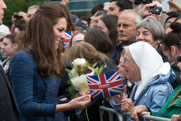 Catherine, Duchess of Cambridge speaks to an elderly nun during a walk about in Civic Square on April 16, 2014 in Wellington, New Zealand. The Duke and Duchess of Cambridge are on a three-week tour of Australia and New Zealand, the first official trip overseas with their son, Prince George of Cambridge.