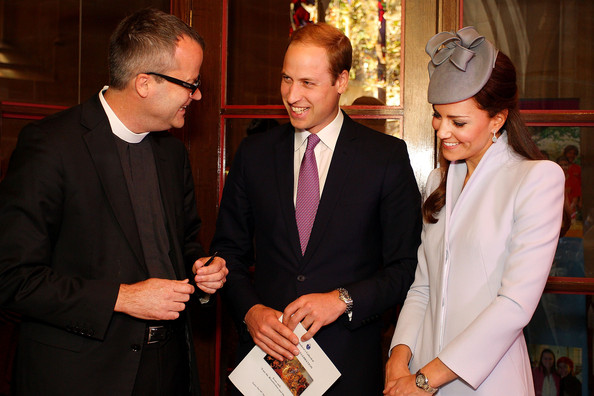 Prince William, Duke of Cambridge (C) and Catherine, Duchess of Cambridge (R) prepare to sign the First Fleet Bible and Prayer Book following Easter Sunday Service at St Andrews Cathedral on April 20, 2014 in Sydney, Australia. The Duke and Duchess of Cambridge are on a three-week tour of Australia and New Zealand, the first official trip overseas with their son, Prince George of Cambridge.