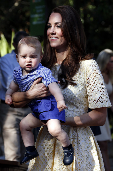 Catherine, Duchess of Cambridge carries her son Prince George of Cambridge as she walks towards the enclosure to see an Australian animal called a Bilby, which has been named after the young Prince, during a visit to Sydney's Taronga Zoo on April 20, 2014 in Sydney, Australia. The Duke and Duchess of Cambridge are on a three-week tour of Australia and New Zealand, the first official trip overseas with their son, Prince George of Cambridge.