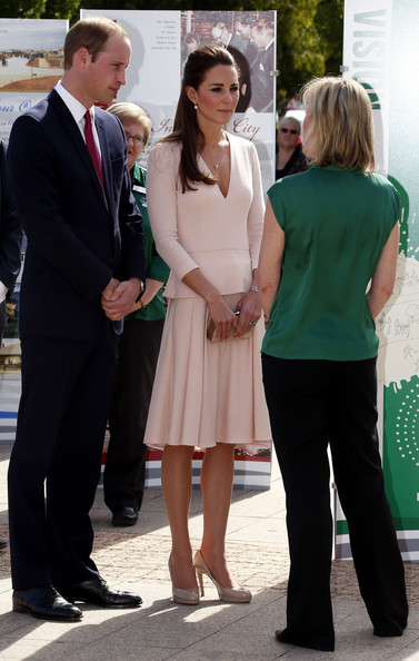 Prince William, Duke of Cambridge and Catherine, Duchess of Cambridge, listen to a local official outside the Playford Civic Centre in the Adelaide suburb of Elizabeth on April 23, 2014 in Adelaide, Australia. The Duke and Duchess of Cambridge are on a three-week tour of Australia and New Zealand, the first official trip overseas with their son, Prince George of Cambridge.