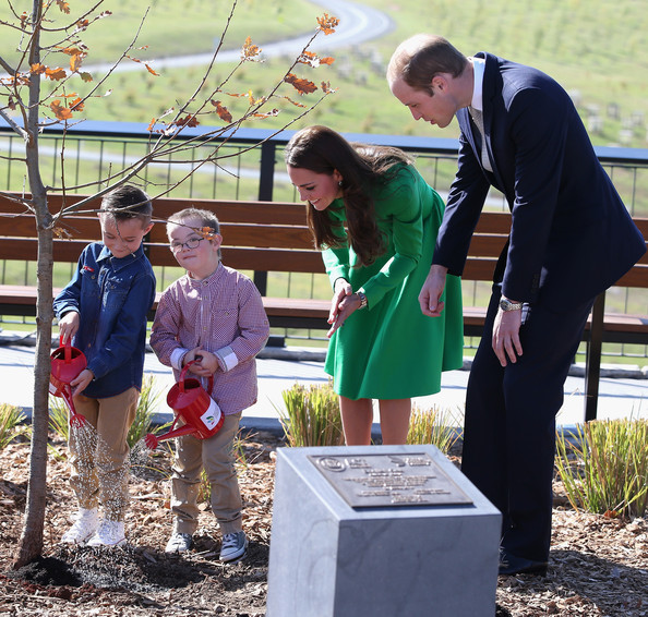 Catherine, Duchess of Cambridge and Prince William, Duke of Cambridge watch two children help them with a tree planting as they visit the National Arboretum on April 24, 2014 in Canberra, Australia. The Duke and Duchess of Cambridge are on a three-week tour of Australia and New Zealand, the first official trip overseas with their son, Prince George of Cambridge.