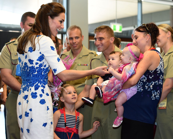Catherine, Duchess of Cambridge (L) says hello to six-month-old Alyssa McCabe, held by her mother Jillian (R) as she meets with families of service personnel at the Royal Australian Airforce Base at Amberley on April 19, 2014 in Brisbane, Australia. The Duke and Duchess of Cambridge are on a three-week tour of Australia and New Zealand, the first official trip overseas with their son, Prince George of Cambridge.