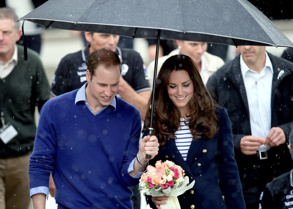 Prince William, Duke of Cambridge (L) and Catherine, Duchess of Cambridge arrive in the rain at the Viaduct Basin in Auckland on April 11, 2014 in Auckland, New Zealand. The Duke and Duchess of Cambridge are on a three-week tour of Australia and New Zealand, the first official trip overseas with their son, Prince George of Cambridge.