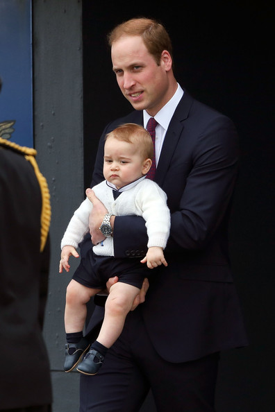 Prince William, Duke of Cambridge and Prince George of Cambridge walk onto the tarmac for their departure at Wellington Airport's military terminal April 16, 2014 in Wellington, New Zealand. The Duke and Duchess of Cambridge are on a three-week tour of Australia and New Zealand, the first official trip overseas with their son, Prince George of Cambridge.