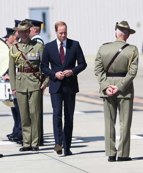 Prince William, Duke of Cambridge inspects a honour Guard as he arrives at the Royal Australian Airforce Base at Amberley on April 19, 2014 in Brisbane, Australia. The Duke and Duchess of Cambridge are on a three-week tour of Australia and New Zealand, the first official trip overseas with their son, Prince George of Cambridge.