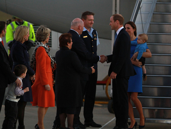 Prince William, Duke of Cambridge shakes hand with the Governor General of Australia, Sir Peter Cosgrove as the Royal Family arrive at Fairbairn Airport on April 20, 2014 in Canberra, Australia. The Duke and Duchess of Cambridge are on a three-week tour of Australia and New Zealand, the first official trip overseas with their son, Prince George of Cambridge.