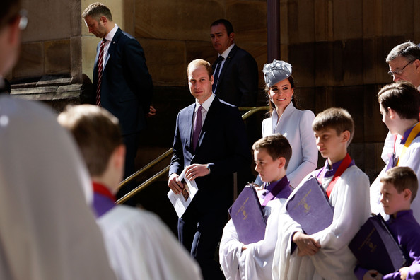 Prince William, Duke of Cambridge and Catherine, Duchess of Cambridge are escorted past members of the cathedral choir following Easter Sunday Service at St Andrews Cathedral on April 20, 2014 in Sydney, Australia. The Duke and Duchess of Cambridge are on a three-week tour of Australia and New Zealand, the first official trip overseas with their son, Prince George of Cambridge.