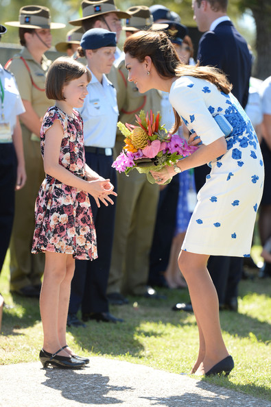 Catherine, Duchess of Cambridge receives flowers from 9 year-old Ashleigh Kearnan during a visit to the Royal Australian Airforce Base at Amberley on April 19, 2014 in Brisbane, Australia. The Duke and Duchess of Cambridge are on a three-week tour of Australia and New Zealand, the first official trip overseas with their son, Prince George of Cambridge.