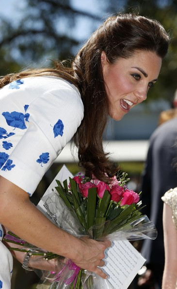 Catherine, Duchess of Cambridge receives a bunch of flowers during a visit to the Royal Australian Airforce Base at Amberley on April 19, 2014 in Brisbane, Australia. The Duke and Duchess of Cambridge are on a three-week tour of Australia and New Zealand, the first official trip overseas with their son, Prince George of Cambridge.