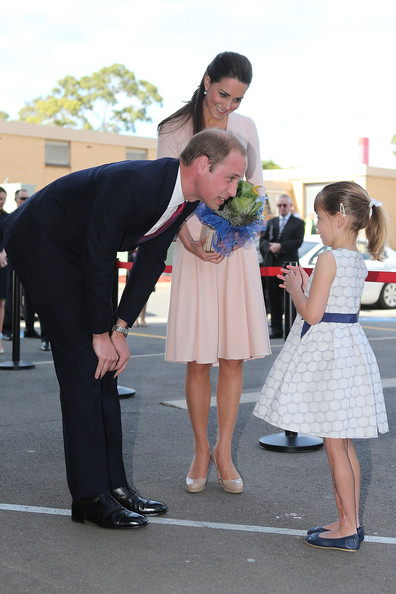 Prince William, Duke of Cambridge and Catherine, Duchess of Cambridge speak to a young girl at the youth community centre, The Northern Sound System, in Elizabeth on April 23, 2014 in Adelaide, Australia. The Duke and Duchess of Cambridge are on a three-week tour of Australia and New Zealand, the first official trip overseas with their son, Prince George of Cambridge.