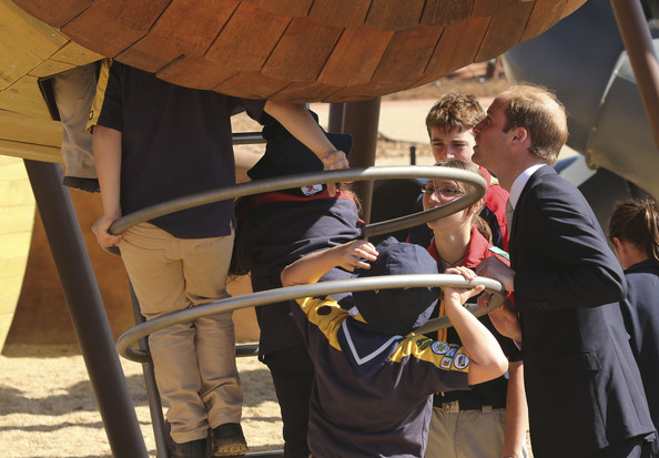 Prince William, Duke of Cambridge watches as children play on apparatus while he walks through the Pod Playground at the National Arboretum on April 24, 2014 in Canberra, Australia. The Duke and Duchess of Cambridge are on a three-week tour of Australia and New Zealand, the first official trip overseas with their son, Prince George of Cambridge.