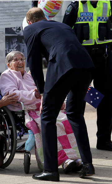 Prince William, Duke of Cambridge greets 100 year old Monica Swarbrick out front of the Playford Civic Centre on April 23, 2014 in Adelaide, Australia. The Duke and Duchess of Cambridge are on a three-week tour of Australia and New Zealand, the first official trip overseas with their son, Prince George of Cambridge.