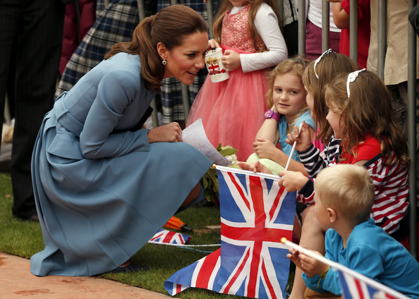 Catherine, Duchess of Cambridge speaks with children at a ceremony at the war memorial in Seymour Square on April 10, 2014 in the town of Blenheim, New Zealand. The Duke and Duchess of Cambridge are on a three-week tour of Australia and New Zealand, the first official trip overseas with their son, Prince George of Cambridge.