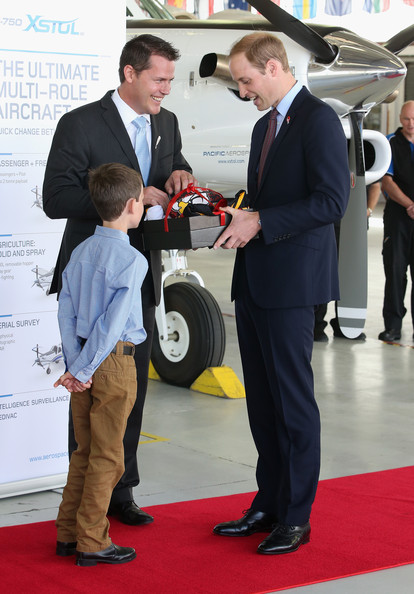 Prince William, Duke of Cambridge is presented with a rugby ball and jerseys as he visits Pacific Aerospace on April 12, 2014 in Hamilton, New Zealand. The Duke and Duchess of Cambridge are on a three-week tour of Australia and New Zealand, the first official trip overseas with their son, Prince George of Cambridge.