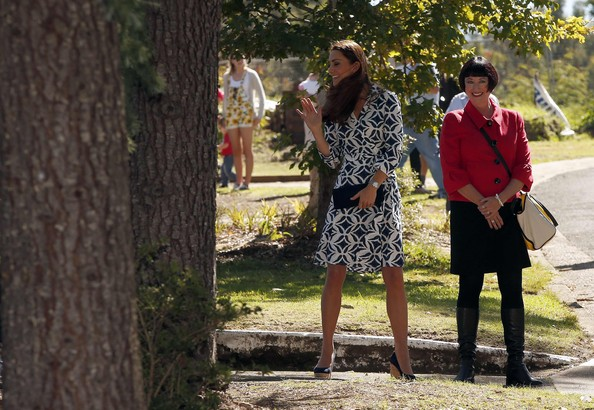 Catherine, Duchess of Cambridge waves to residents as she walks with local official Miranda Hansen along a road in the Blue Mountains suburb of Winmalee, that lost homes during bushfires last year, during a visit with her husband, on April 17, 2014 in Katoomba, Australia. The Duke and Duchess of Cambridge are on a three-week tour of Australia and New Zealand, the first official trip overseas with their son, Prince George of Cambridge.