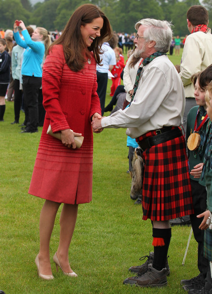 Catherine, Duchess of Cambridge talks to a man in a kilt during a visit to Strathearn Community Campus on May 29, 2014 in Crieff, Scotland. The Duke and Duchess of Cambridge will spend the day in Scotland where they will tour a distillery and visit a village fete.