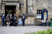 Mila Sneddon, 5, with her sister Jodi, and mother Lynda waves to the Duke and Duchess of Cambridge, during the Beating of the Retreat at the Palace of Holyroodhouse on May 27, 2021 in Edinburgh, Scotland. Cancer patient Mila features in an image from the Hold Still photography project which showed her kissing her father Scott through a window whilst she was shielding during her chemotherapy treatment.