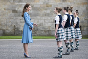 Catherine, Duchess of Cambridge meets Highland dancers during a Beating of the Retreat at the Palace of Holyroodhouse on May 27, 2021 in Edinburgh, Scotland.
