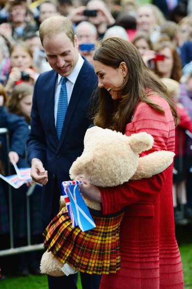Catherine, Duchess of Cambridge holds a bear as Prince William, Duke of Cambridge and her visit MacRostyy Park on May 29, 2014 in Crieff, Scotland. The Duke and Duchess of Cambridge will spend today in Scotland where they will tour adistillery and visit a village fete.