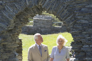 Prince Charles, Prince of Wales and Camilla, Duchess of Cornwall walk through the ruins of Tintagel Castle during their visit to Cornwall, south west England on July 20, 2020 in Tintagel, England.