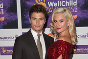 Oliver Cheshire and Pixie Lott attend the WellChild awards at Royal Lancaster Hotel on October 15, 2019 in London, England.