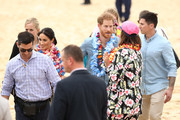 Prince Harry, Duke of Sussex and Meghan, Duchess of Sussex talk to Sam Schumacher, co-founder of OneWave, a local surfing community group raising awareness for mental health and wellbeing on Bondi Beach on October 19, 2018 in Sydney, Australia. The Duke and Duchess of Sussex are on their official 16-day Autumn tour visiting cities in Australia, Fiji, Tonga and New Zealand.